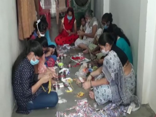 A group of women making rakhis in Prayagraj (Photo/ANI)