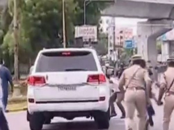 A screen grab of the visual with the man jumping in front of the CM's convoy. Photo/ANI