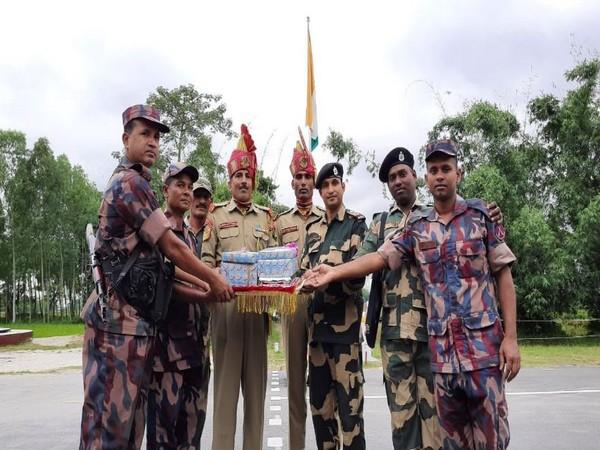 BSF troops exchanged sweets with Border Guards Bangladesh (BGB) at Indo-Bangladesh border at BOP Fulbari, Siliguri (Photo/ANI)