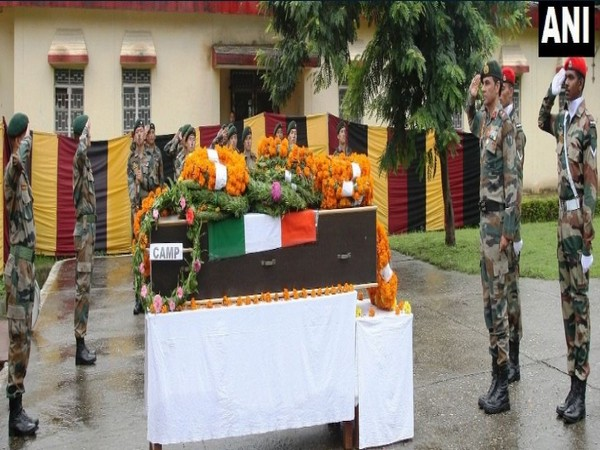 Indian Army paying tribute to martyr, Naik Krishan Lal on Wednesday. (Photo/ANI)