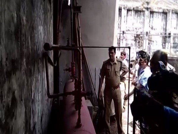 Uttar Pradesh police inspecting the oil mill after the pipe burst on Tuesday. Photo/ANI