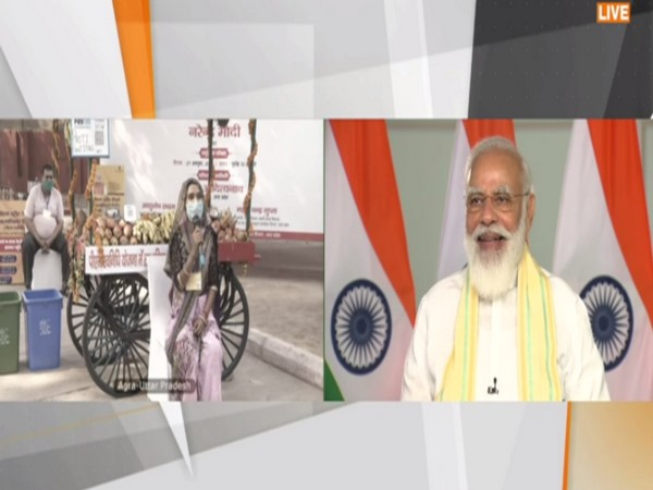 Prime Minister Narendra Modi interacting with SVANidhi beneficiaries. (Photo/ANI)