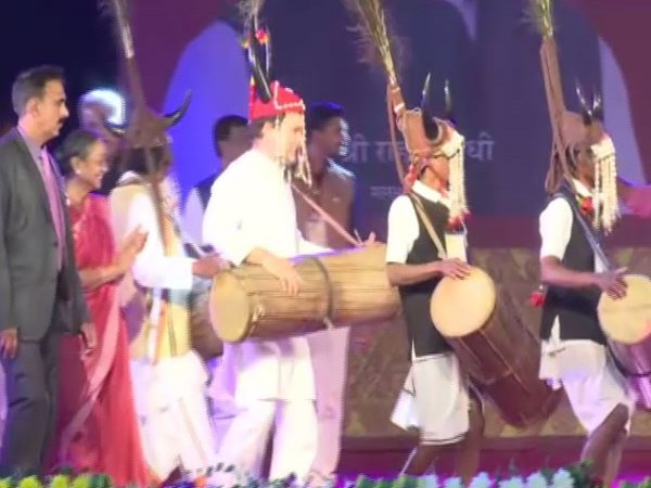 Congress leader Rahul Gandhi shaking a leg with tribal community on Friday (Photo/ANI)