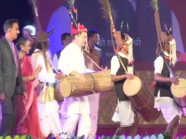 Congress leader Rahul Gandhi shaking a leg with tribal community on Friday (Photo/ANI)