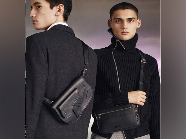 Models flaunt Dior's latest collection of bags for men (Photo: Instagram) )