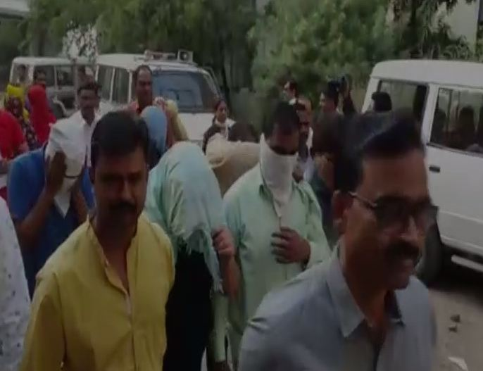 Crime branch officials taking the accused from the spot (Photo/ANI)