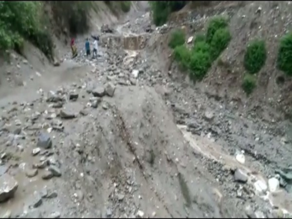 The road which was damaged after cloudburst on Thursday (Photo/ANI)