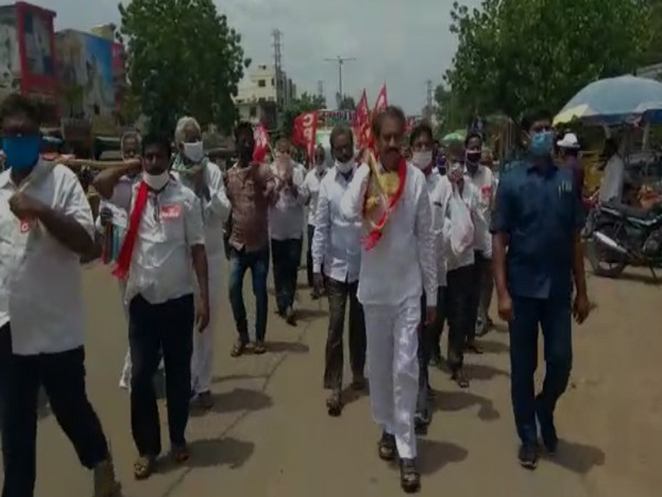 CPI Andhra Pradesh Unit held protest at Mangalagiri town, against hike of petrol and diesel prices across the country (Photo/ANI)