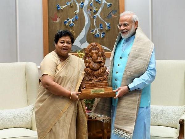 Chhattisgarh Governor Anusuiya Uikey gifted an idol of Ganesha to PM Narendra Modi on Monday. (Photo/ANI)