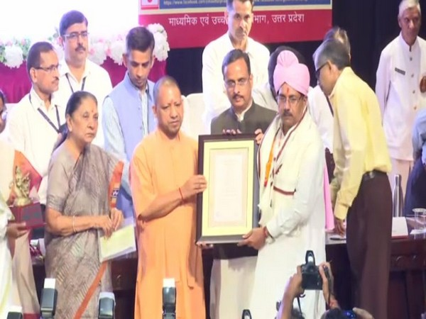 Governor Anandiben Patel and Chief Minister Yogi Adityanath while honouring teachers during an event in Lucknow on Thursday. (Photo/ANI)
