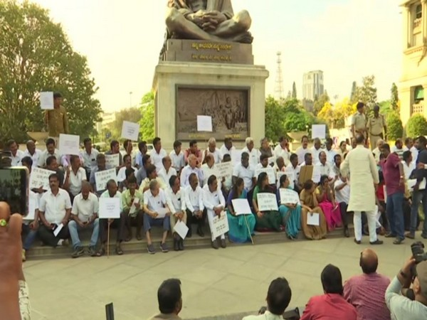 Congress staged protest in front of Mahatma Gandhi's statue at Vidhana Soudha in Bengaluru on Wednesday (Photo/ANI)