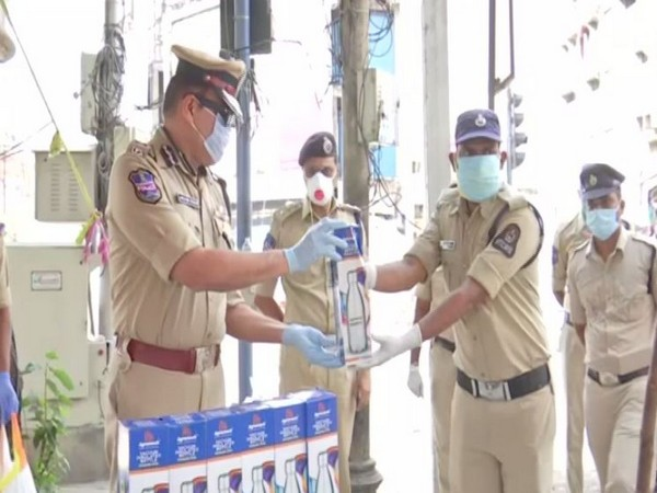 Hyderabad Police Commissioner, Anjani Kumar distributed Thermo steel bottles to police personnel (Photo/ANI)