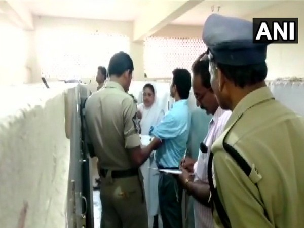 Police officials investigating the matter. (Photo/ANI)