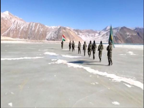 ITBP jawans walking on a frozen water body in Ladakh on Republic Day.