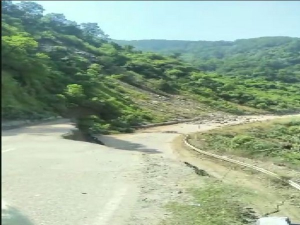 A portion of the road sunk in Sirmaur district due to a landslide. Photo/ANI