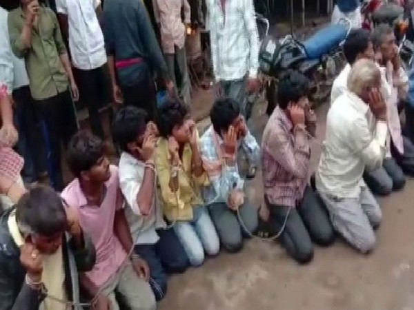 Villagers chained the cow smugglers. Photo/ANI