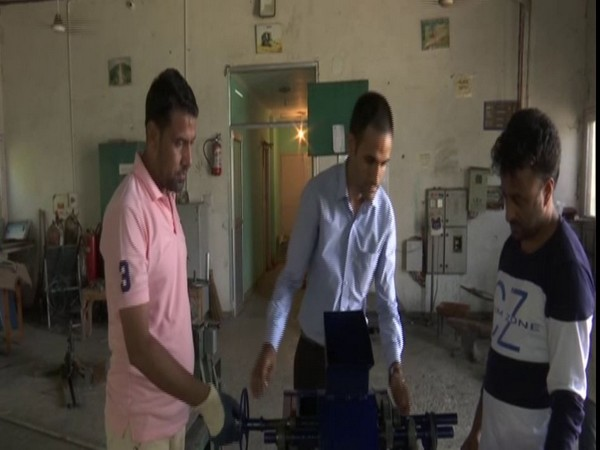 Dr Mohd Muzamil (Middle), at the Test Lab Centre of Sher-e-Kashmir University of Agricultural Sciences and Technology in Jammu (Photo/ANI)