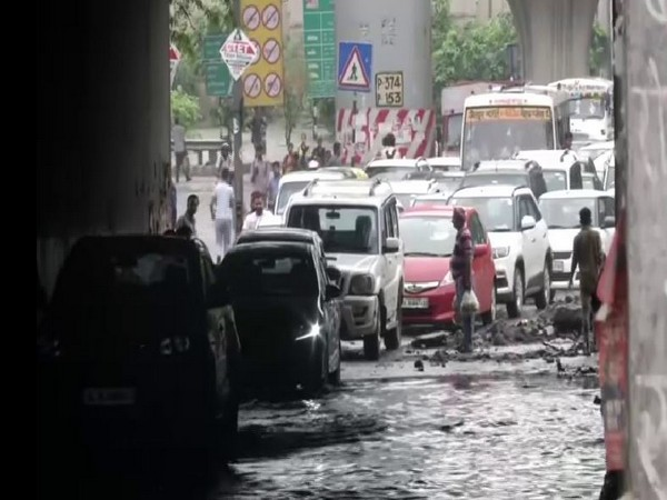 Commuters faced traffic snarls due to water logging in Tughlakabad-Prahladpur area, Delhi on Thursday (Photo/ANI)