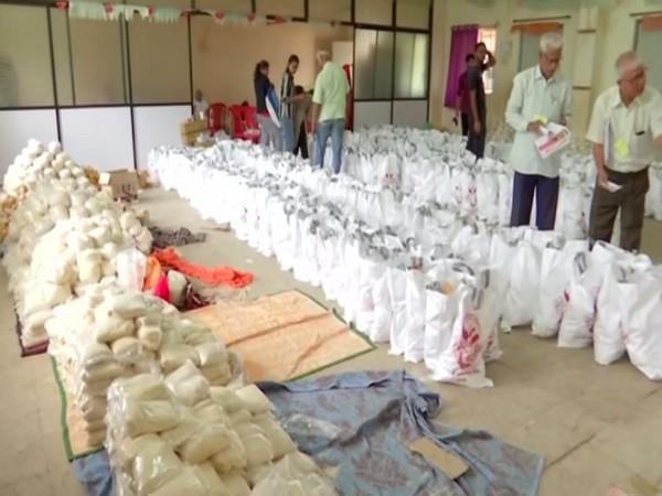 Rashtriya Swayamsevak Sangh (RSS) cadres send almost 5,000 to 6,000 food packets in flood-affected Sangli district. (Photo/ANI)