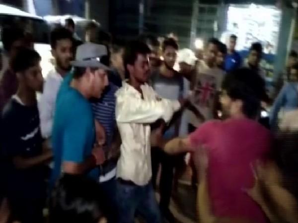 Locals thrashing the goon in Bihar's Nalanda (Photo/ANI)