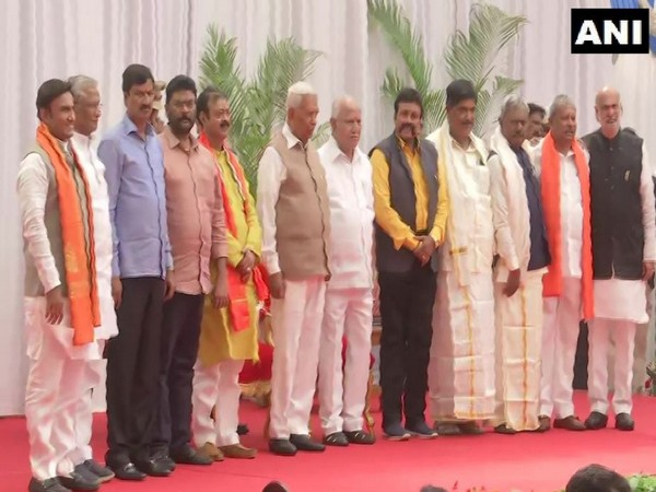 Karnataka Chief Minister BS Yediyurappa and Governor Vajubhai Vala with the ten newly-inducted Cabinet Ministers at Raj Bhawan in Bengaluru (Photo/ANI)