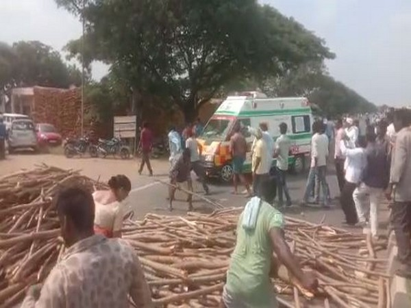 Farmers today blocked the highway by dumping their produce on the road (Photo/ANI)
