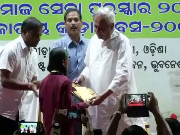 Chief Minister Naveen Patnaik congratulating a player with an award in Odisha on Thursday Photo/ANI