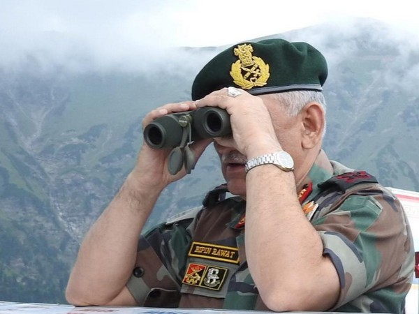 Army Chief on Saturday looks across Line of Control into Pakistan Occupied Kashmir. (Picture tweeted by Defence Ministry)