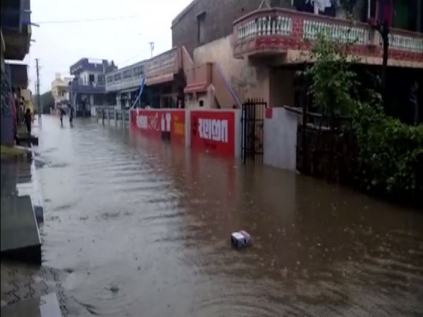 Heavy downpour led to severe water logging in several parts across several parts in Anand district, Gujarat (Photo/ANI)