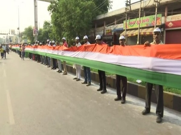 Locals conducted 15-km tricolour flag rally formed by human chain in Raipur on Sunday. (Photo/ANI)