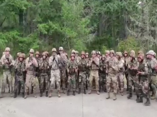 Indian and American soldiers tapping to an Assamese marching song during a joint military training on Sunday. Photo/ANI