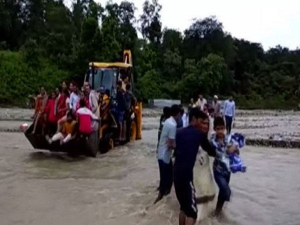 Stranded devotees being rescued by the local administration. Photo/ANI