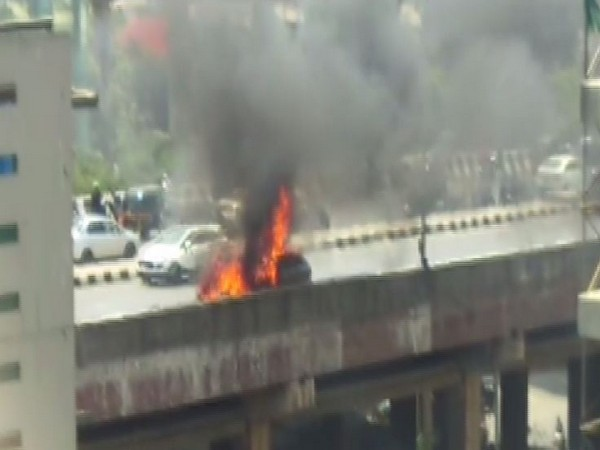 A car on Sunday caught fire at the Western Express highway in Mumbai