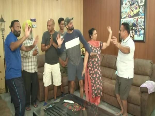 Hockey player Mandeep Singh's family celebrating India's win at Tokyo Olympics. (Photos/ANI)