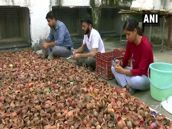 The youth welfare association are cleaning the lamps and will sell them in the market in Chandigarh. Photo/ANI
