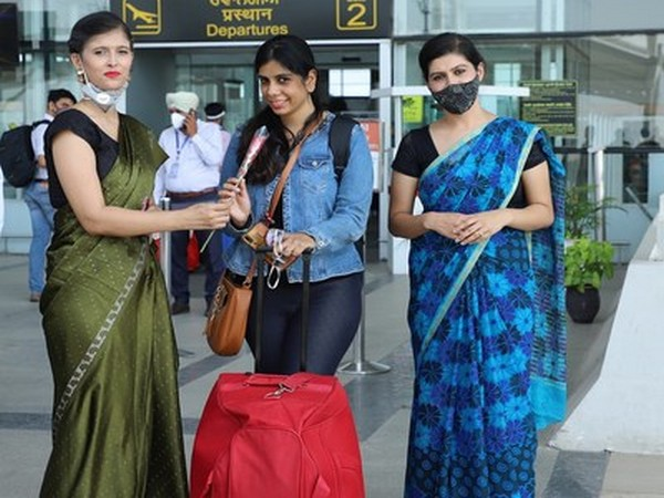 Chandigarh University students and faculty welcoming tourists at Chandigarh International Airport on the eve of World Tourism Day