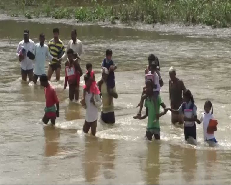 Parents carrying their children on shoulders to drop them to school [Photo/ANI]