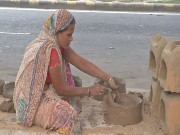 A muslim artisan preparing Earthen Chulha for Chhath Puja
