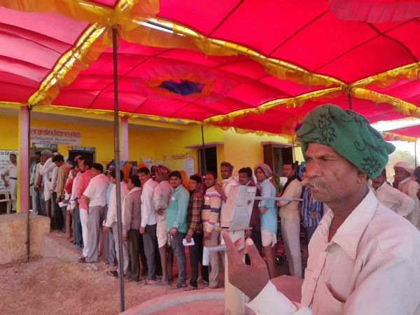 Tribals and villagers queued outside polling booth in Dhar district of Chhattisgarh