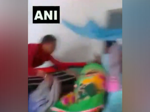 A video shows the man dragging the cleaner at Barwani Kanya Ashram in Korea district of Chhattisgarh.