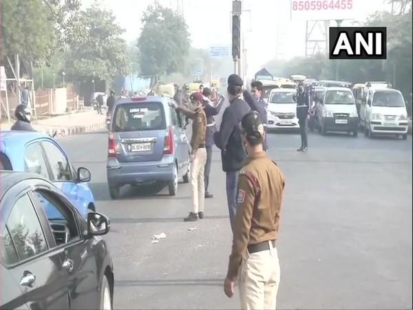 Traffic police manage vehicular movement near Chilla village in Delhi on Wednesday. (Photo/ANI)
