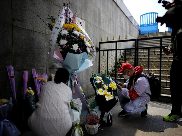 People pay tribute to the deceased in Wuhan who died of the coronavirus disease on the Qingming tomb-sweeping festival, observed on April 4