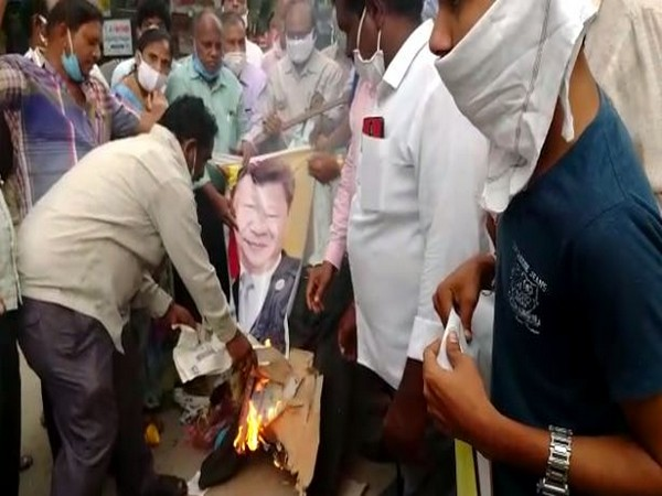 The protesters set ablaze the effigy of Chinese President Xi Jinping in Telangana's Suryapet on Sunday. Photo/ANI