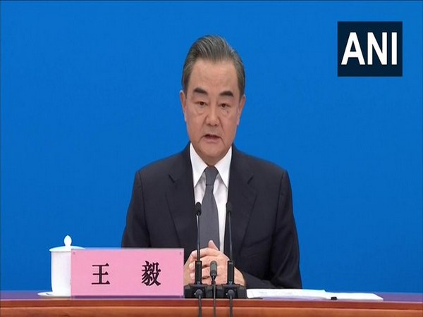 China's Foreign Minister Wang Yi addresses a press briefing on Sunday