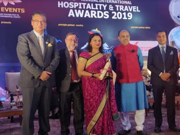 Chitra Awasthi, Director of Sales and Marketing in JW Marriott Mussoorie Walnut Grove Resort & Spa with the award