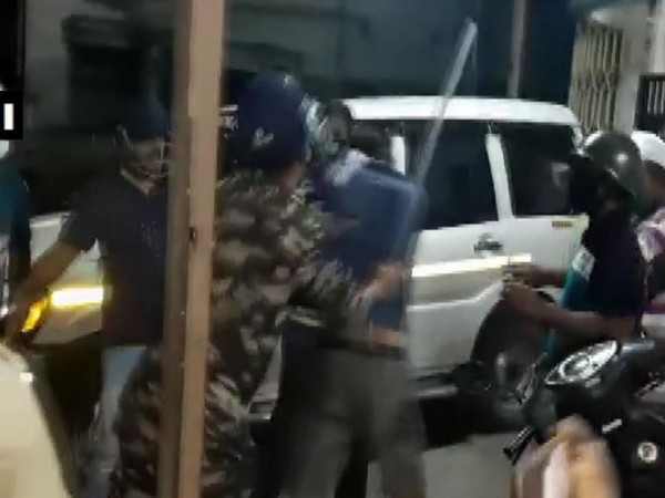 Police using baton to disperse the BJP and TMC supporters in Howrah.