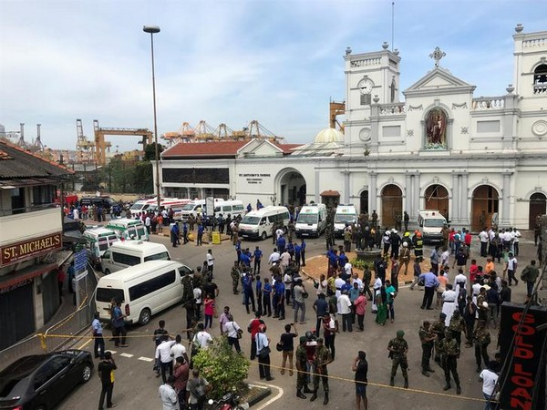 Forces gather outside St. Anthony's Church in Kochchikade after multiple bomb blasts rocked the city on Sunday