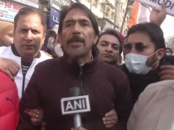 Jammu and Kashmir Congress Chief Ghulam Ahmed Mir holding a protest on Friday here in Jammu over farm laws. (Photo/ANI)