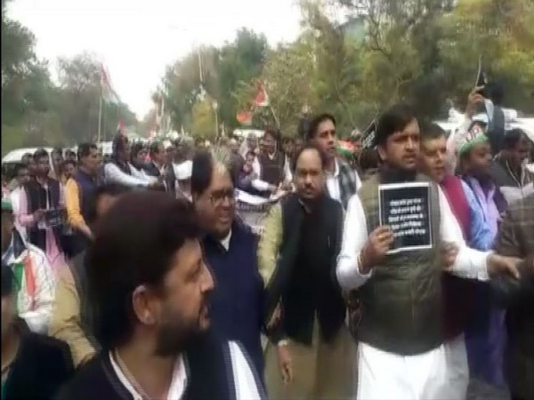 Congress workers on Monday took out march to SSP office against the murder of Gaurav Chandel. Photo/ANI