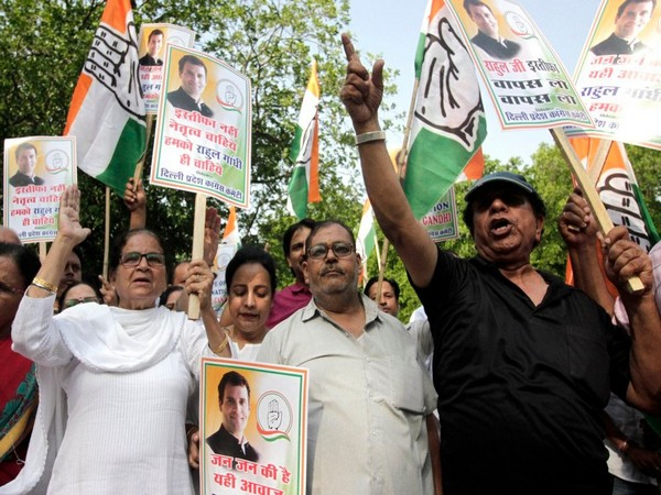 Congress supporters hold placards during a protest outside party president Rahul Gandhi residence at Tughlak lane in New Delhi on Wednesday.